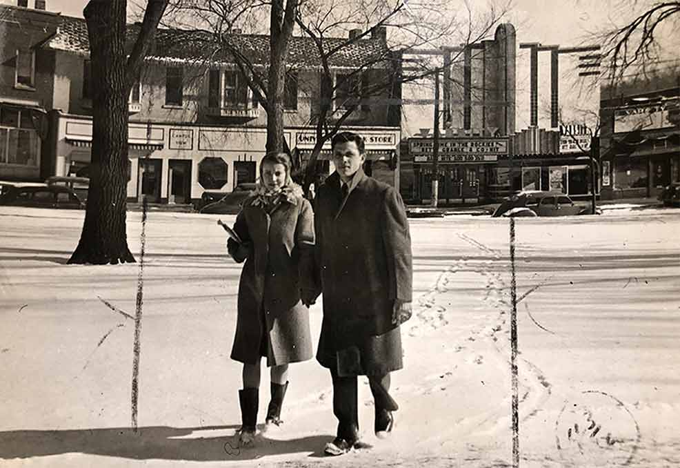 A couple walking near the Varsity Theatre in Des Moines, Iowa